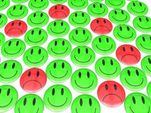 Sad Smiley in the Midst of Happiness Stock Photography