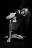 Sad smoking blond. Girl thinker on black background, monochrome Royalty Free Stock Images