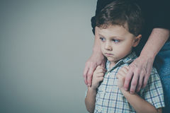 Sad son hugging his mother at home. Concept of couple family is in sorrow Stock Photography