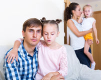 Sad spouses with two daughters Stock Images