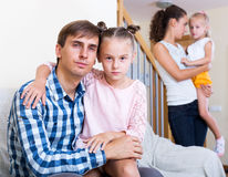 Sad spouses with two daughters Stock Image