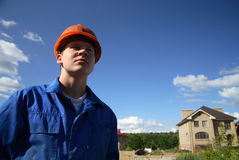 In a sad state working man in the helmet. And sky background Stock Photography