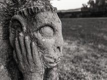 Sad Stone Gargoyle in Franconia, Germany Royalty Free Stock Images