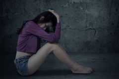 Sad and stressed girl sitting alone Royalty Free Stock Photo
