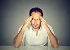 Sad stressed man thinking intensely concentrating preoccupied Royalty Free Stock Images