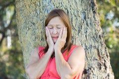 Sad stressed mature woman outdoor stock photos