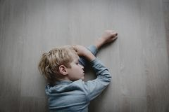 Sad stressed tired exhausted child at home. Depression stock images