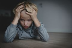 Sad stressed tired exhausted child at home. Depression stock image