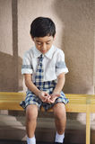 Sad studen lonely at school Stock Images