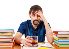 Sad Student with Alcohol. On the Desk Isolated on the White Background Stock Photo