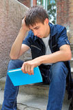 Sad Student with the Book Royalty Free Stock Image