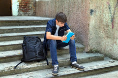 Sad Student with the Book Royalty Free Stock Photo