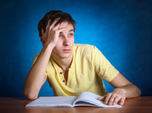 Sad Student with a Book Royalty Free Stock Images