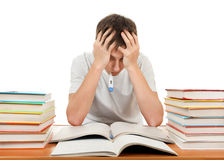 Sad Student with a Books. Sad and Sick Teenager with Thermometer and Books on the White Background Royalty Free Stock Images