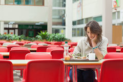 Sad student in the cafeteria with food tray Stock Photography
