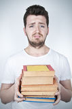 Sad student holding books Royalty Free Stock Photography