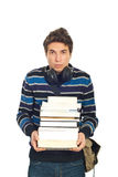 Sad student male carrying books. Sad student male with headphones carrying stack of book isolated on white background Stock Photo