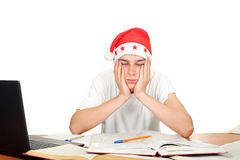 Sad student in santa hat Stock Photography