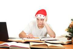 Sad student in santa's hat Royalty Free Stock Photography