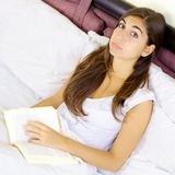 Sad student tired of reading book Stock Photo