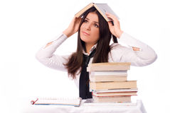 Sad student unwilling ot do homework. Beautiful sad student unwilling to do homework isolated against white background Royalty Free Stock Photography
