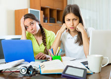 Sad students studying at home Royalty Free Stock Photo
