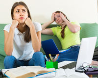 Sad students studying at home Stock Photo