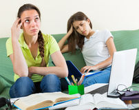 Sad students studying at home Royalty Free Stock Images