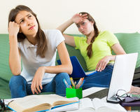 Sad students studying at home Royalty Free Stock Photos
