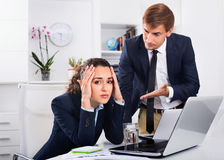 Sad subordinate woman being accused to making mistake by man col. Sad dreary  subordinate women being accused to making mistake by men colleague in company Stock Image