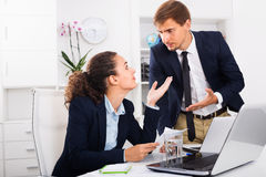 Sad subordinate woman being accused to making mistake by man col. Frustrated subordinate women being accused to making mistake by men colleague in company office Royalty Free Stock Photo