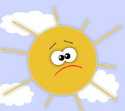 Sad sun. In the sky with clouds Royalty Free Stock Images