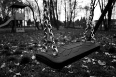Sad swing. In a park plays Royalty Free Stock Images