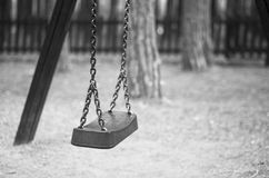 Sad empty swing. Empty swing in a black and white image give the sensation of sadness Stock Photography