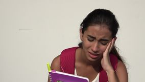 Sad Tearful Teen Female Student. A young female hispanic teen stock video