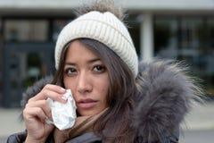 Sad tearful woman holding a handkerchief Royalty Free Stock Photos