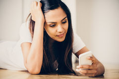 Sad teeange girl video messaging mobile phone Stock Image