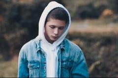 Free Sad Teen Boy Outdoors Royalty Free Stock Photo - 158058535