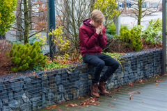 Sad teen boy praying outdoor in city park for future feeling ner. Sad teenager boy crying and praying outdoor feeling nervous about future date and events Stock Photo