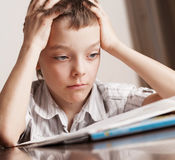 Sad teen doing homework Royalty Free Stock Image