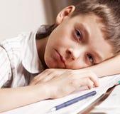 Sad teen doing homework Royalty Free Stock Photo