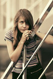 Sad teen girl against a school building Royalty Free Stock Images