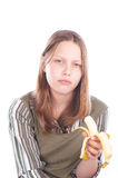 Sad teen girl with banana Stock Images