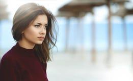 Sad Teen Girl on the Beach. Sad Girl On the Beach Looking. Woman on the Beach Royalty Free Stock Photos