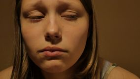 Sad teen girl thinking of something. 4K UHD. Native video stock footage