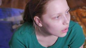 Sad teen girl watching tv, 4K UHD stock footage