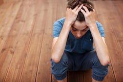 Sad teen indoor Royalty Free Stock Image
