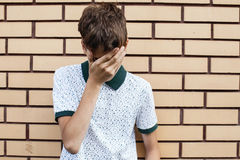 Sad teen outdoors Royalty Free Stock Photo