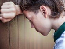 Sad teen outdoors Stock Photos