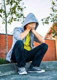 Sad Teenager outdoor. Sad Teen sit on the City Street stock photos